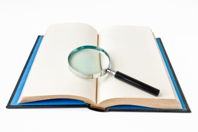 Book with magnifying glass