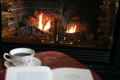 book on a table by a fire