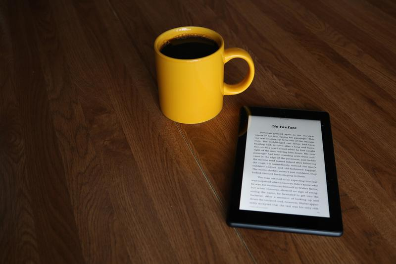 ereader and mug  - What are you reading in July 2019?